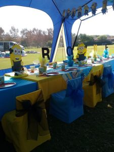 Party Animals Jumping Castles Minions Birthday table layout with yellow and blue