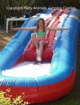 10m_Waterslides_1_Fun_4_Party_Animals_For_all_your_Jumping_Castles_and_party_hire_needs